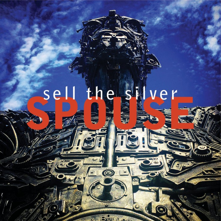 SPOUSE: Sell the Silver cover with giant metal sculpture and blue sky